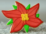 Poinsettia decorated cookie design by Sweet Themes Bakery