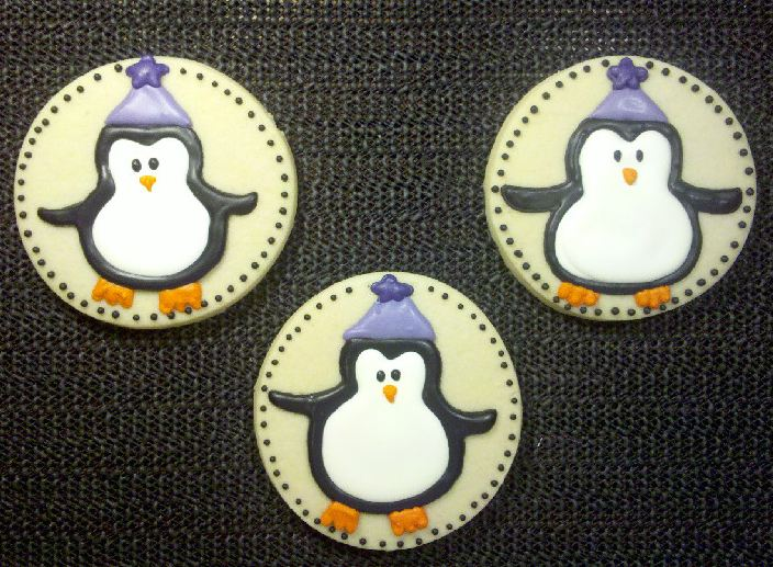 Custom-designed penguin cookies from Sweet Themes Bakery