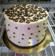 Vanilla Cake with beautiful scroll topping Custom Cake Design at Sweet Themes Bakery Kent Washington